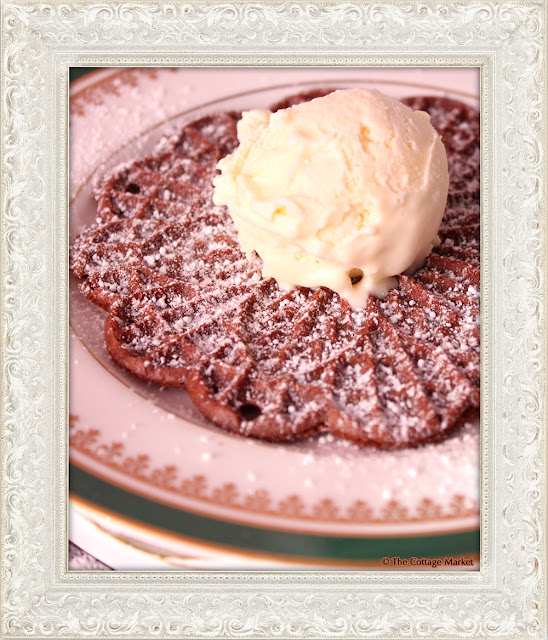 This chocolate pizzelle served with vanilla ice cream and powdered sugar is the perfect dessert.