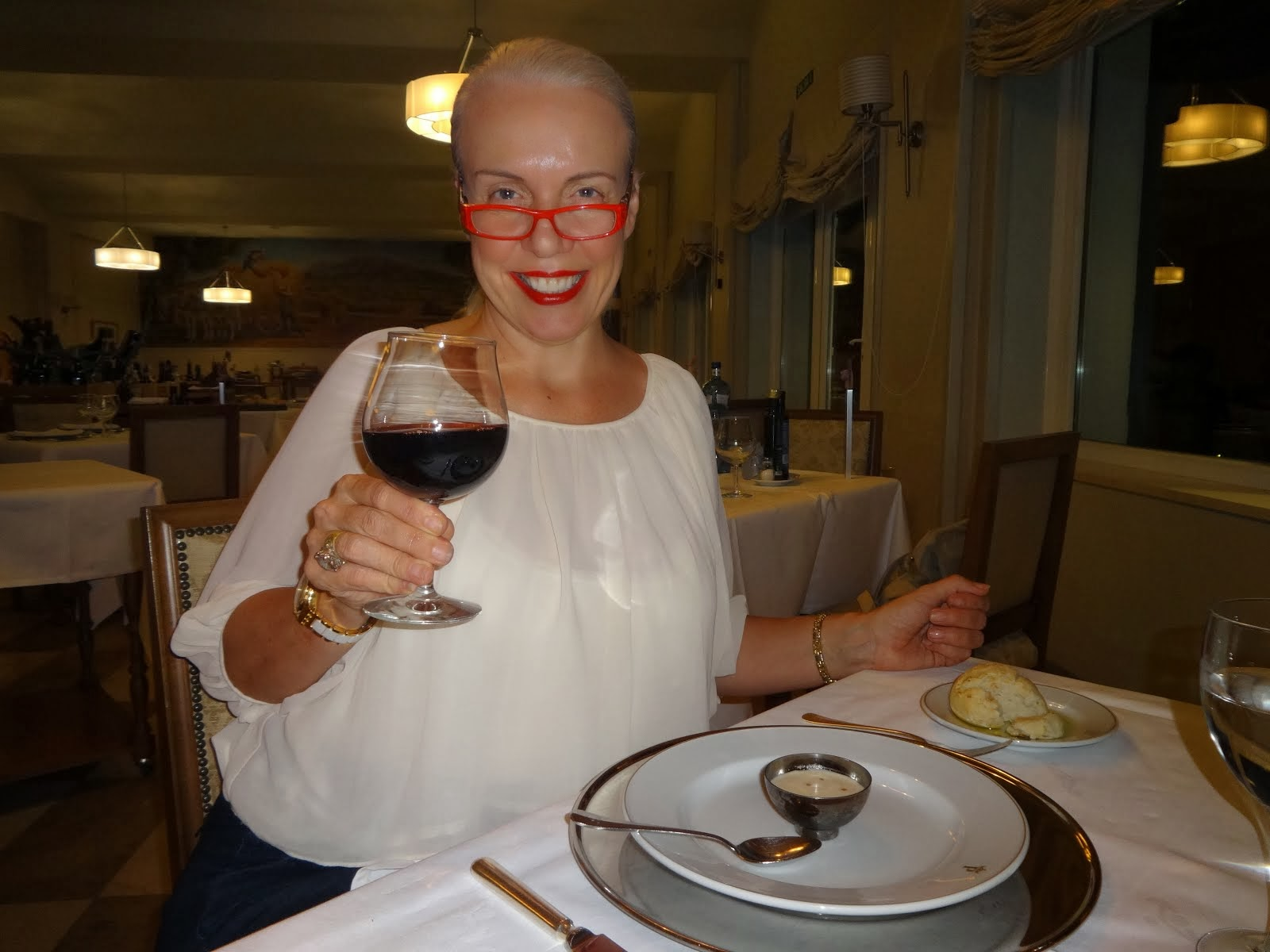 Raising a glass of red to the end of another joyous day in Spain