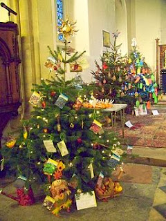 http://commons.wikimedia.org/wiki/File%3AChristmas_Tree_Festival%2C_St_John_the_Evangelist_Church_-_geograph.org.uk_-_1622424.jpg