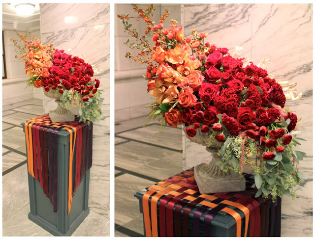 Detroit Institute of arts floral design arrangement  in stone urn ombre fall gem tones deep red burgundy rust orange roses orchids sweet pea floral design Holly Rutt woven ribbon ombre cascade roses st. Therese feast day
