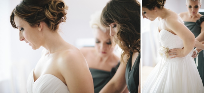Gorgeous bride getting laced into her dress - photos by STUDIO 1208