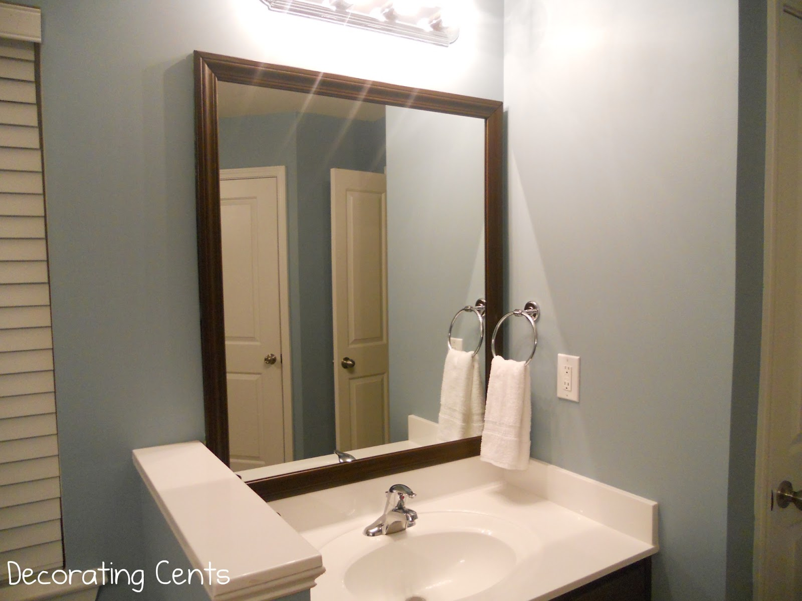 Decorating cents framing the bathroom mirrors for Pictures for your bathroom