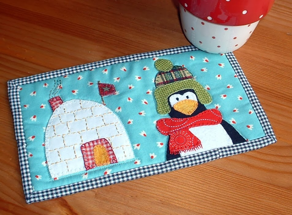 http://www.craftsy.com/pattern/quilting/home-decor/winter-home-mug-rug/35418