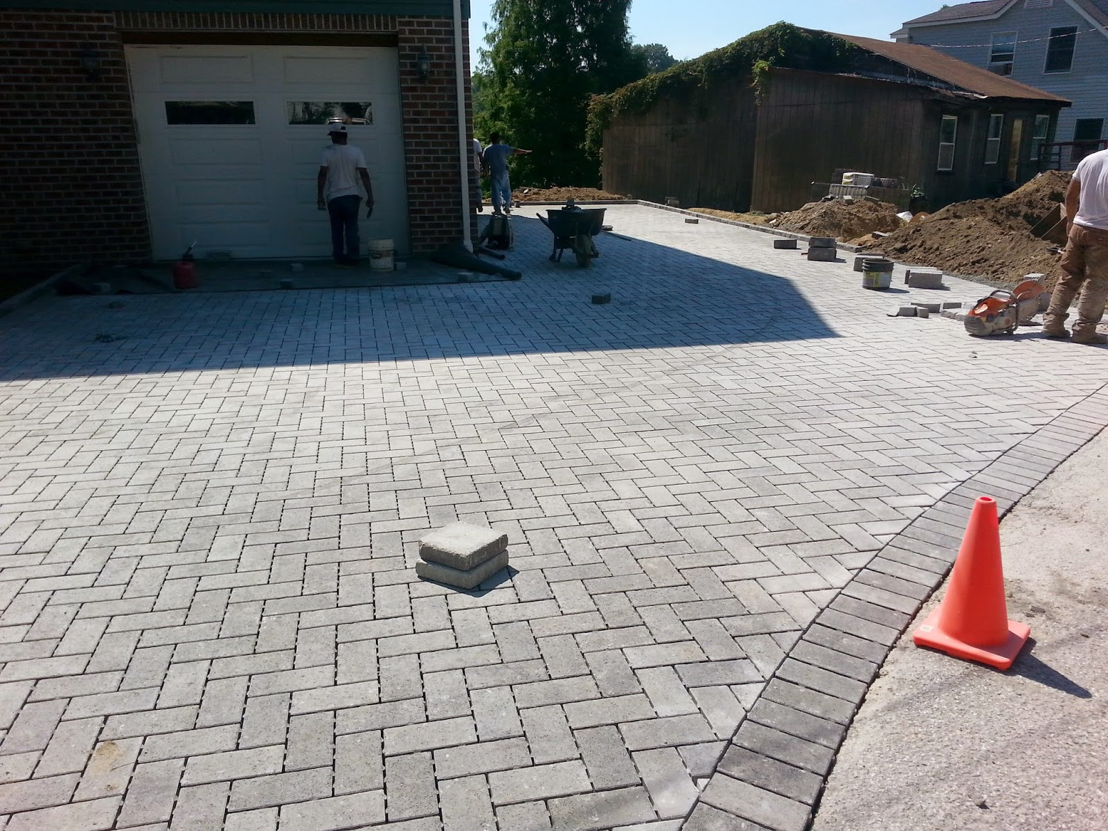 Custom Stoneworks & Design Inc Permeable Pavers for driveway in