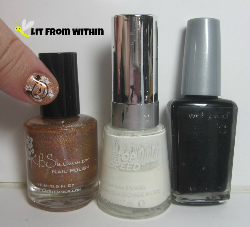 Bottle shot:  KBShimmer Run, It's the Coppers!, Revlon Spirit, and Wet 'n Wild Black Creme