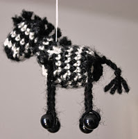 http://www.ravelry.com/patterns/library/miniature-zebra-africa-series