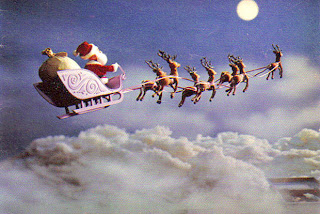 flying reindeer of Santa Claus and X mas gifts sack in the sky clouds and moon Christmas background picture