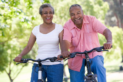 Couple riding bikes