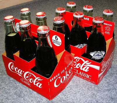 Coke in 6 ounce glass bottles circa 1983 including bottles with Colorado Rockies baseball team logo circa 1990s