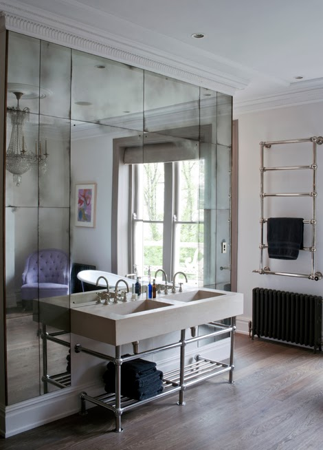 Gorgeous floor to ceiling mirrors behind the bathroom vanity