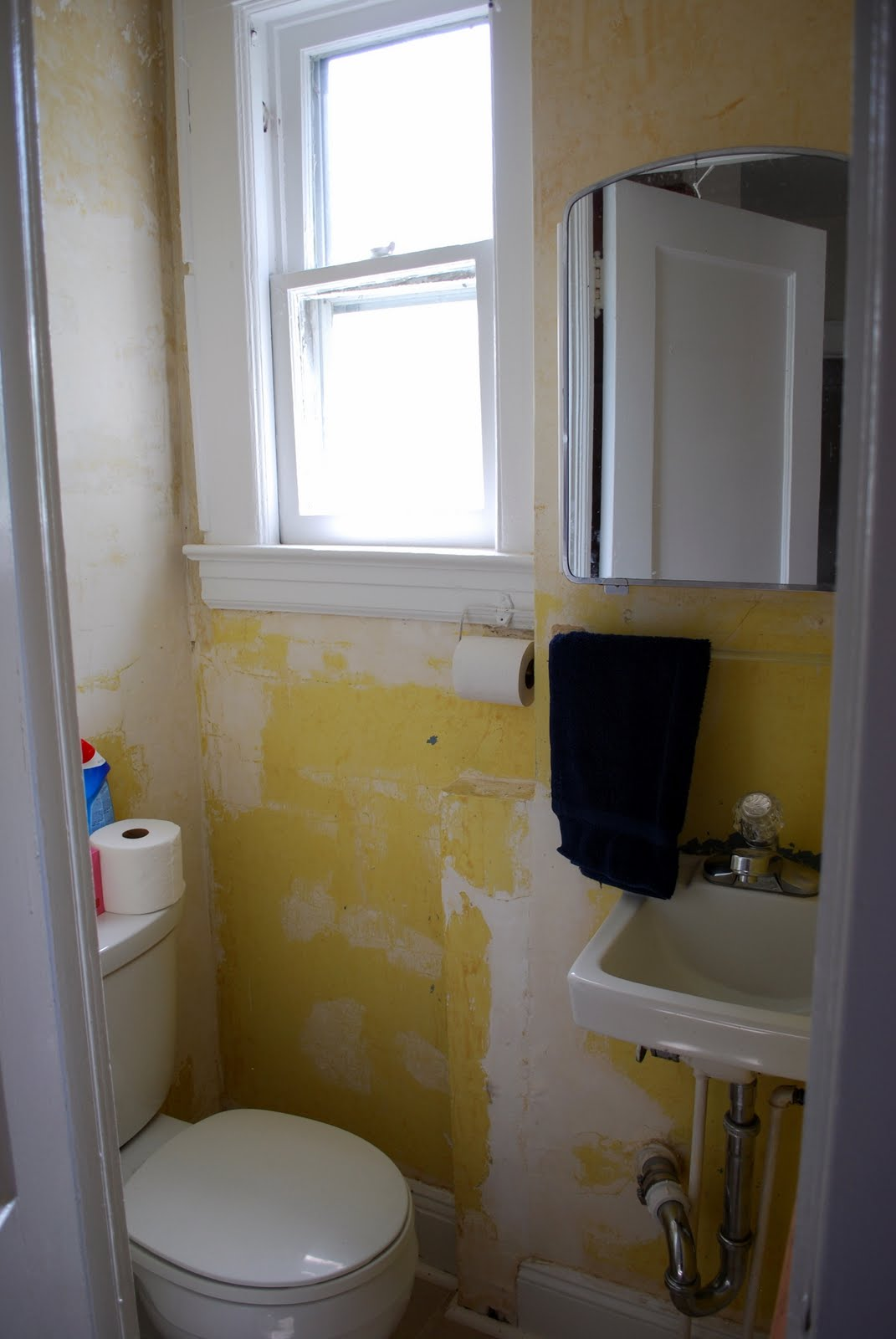 in the little yellow house then now kitchen and half bath