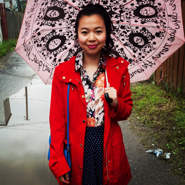 pink umbrella red raincoat floral blouse polka dot skirt