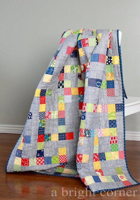 This is a fun, scrappy quilt made with the Mazed quilt pattern