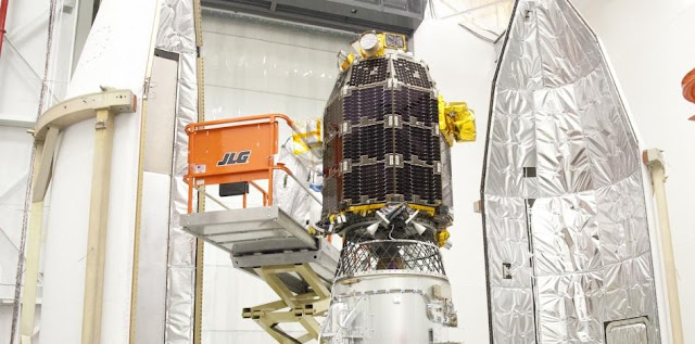 Engineers at NASA's Wallops Flight Facility in Virginia encapsule the LADEE spacecraft into the fairing of the Minotaur V launch vehicle nose-cone. LADEE is the first spacecraft designed, developed, built, integrated and tested at NASA's Ames Research Center in Moffett Field, Calif. Image credit: NASA Wallops / Terry Zaperach
