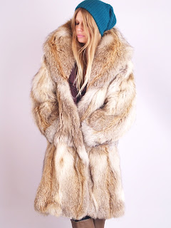 Vintage 1970's tan coyote fur coat with large collar.