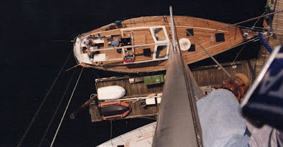 View from 72 ft mast looking down on 50 ft sloop's teak decks