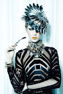 woman eating cockroach, woman eating insects, haute couture, model eating bugs