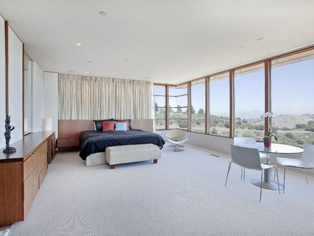 Photo of bedroom with huge windows and the views