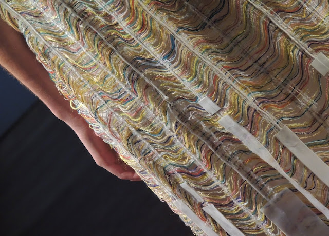 Detail of undulating waves on a maxi-dress from the collection