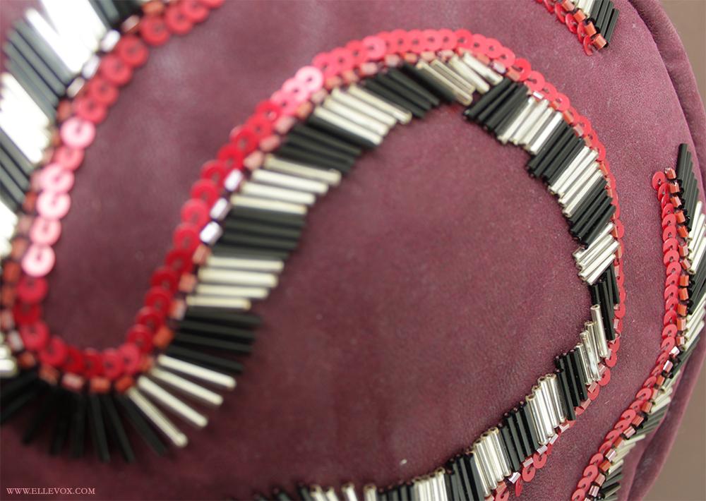 embellished round clutch
