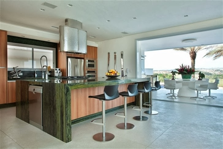 Green kitchen island in Dream home by Pupo Gaspar Arquitetura