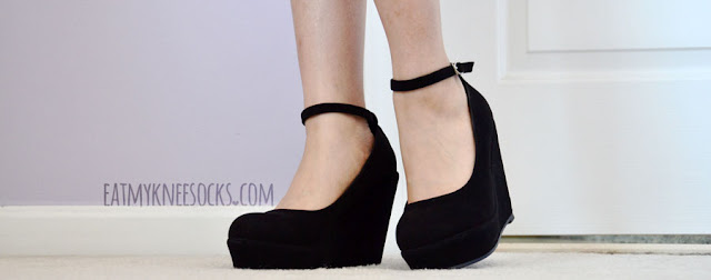 Milanoo's lovely black wedges have a simple ankle strap design and faux-suede material.