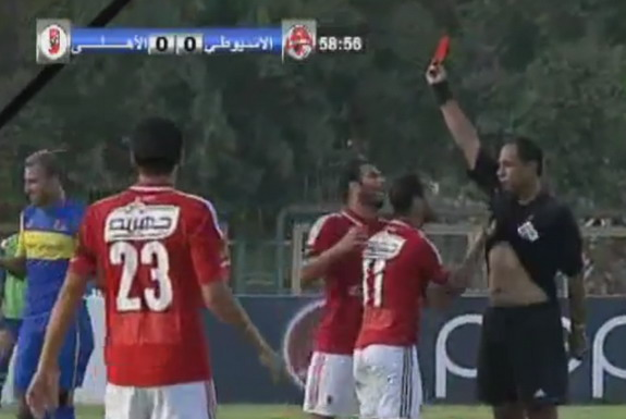 Al Ahly player Walid Soliman is seen lifting up referee's shirt after getting a red card