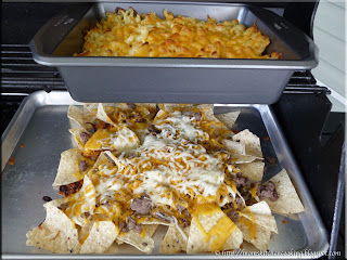 using the outdoor grill to cook mac and cheese and nachos
