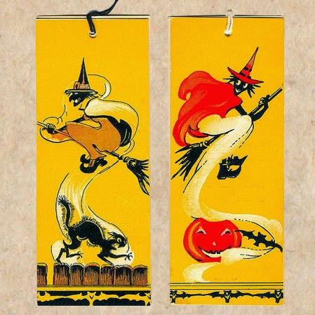 Witches flying on brooms in trails of smoke against bright yellow accompanied by black cat, pumpkin JOL, and bat motif.