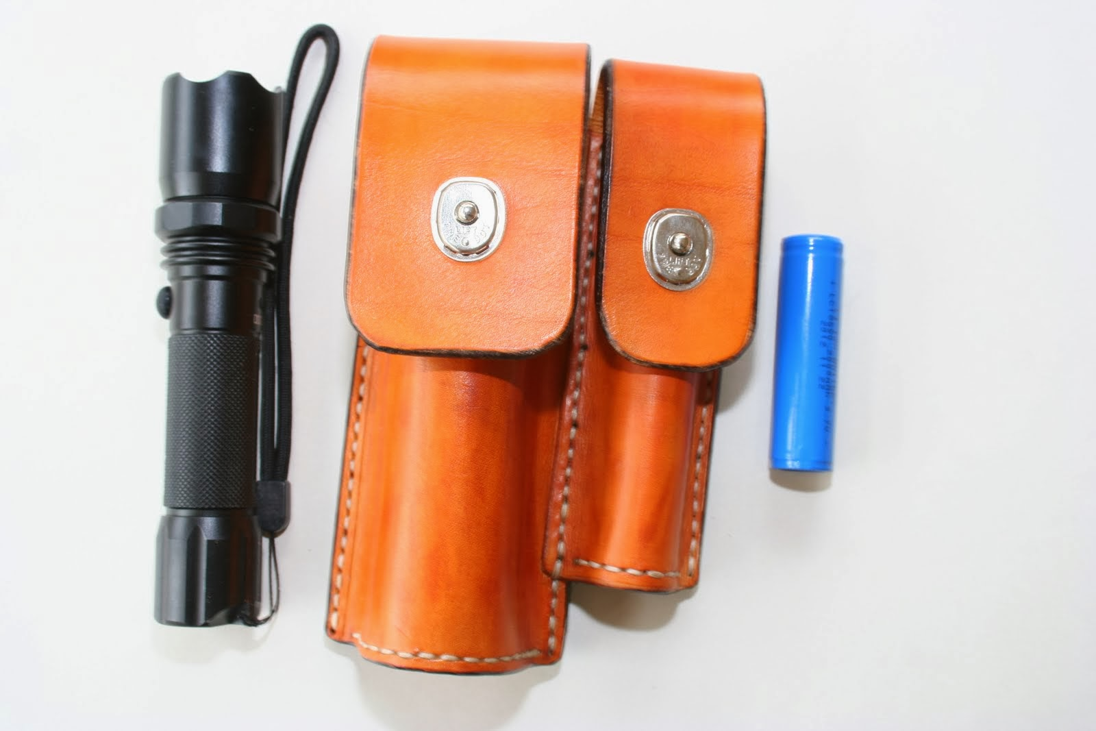 Combination torch and battery belt pouch