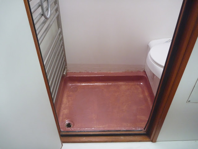A layer of twill weave fibreglass cloth and fairing filler repairing motorhome shower tray
