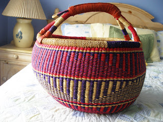 red and blue woven basket from Ghana