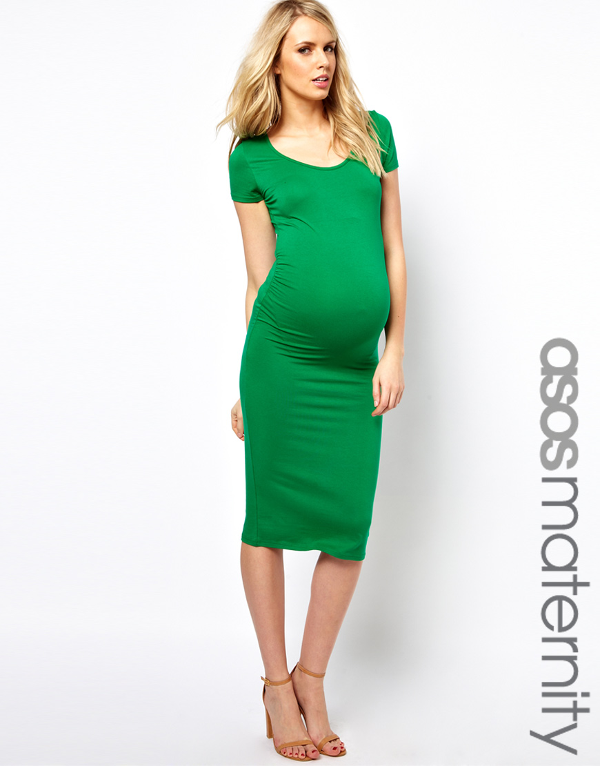 Stunning ASOS maternity swing dress with seam detail and Soft-touch jersey Crew neckline Button keyhole back Relaxed fit Designed to fit through all stages of pregnancy Machine wash 95% Viscose, 5% Elastane There is a faint mark on the front - see photos but you can hardly see it.