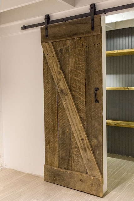rustic, laundry room with sliding barn door