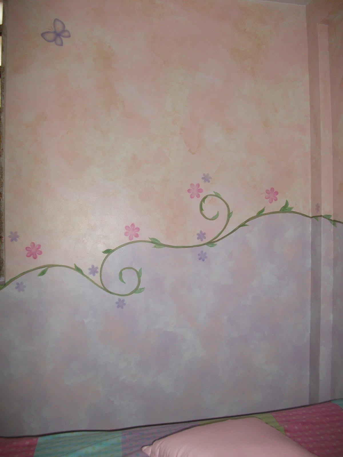 decoracion con cenefas para bebe pintadas y asimetricas en forma de ramas y motivos sueltos