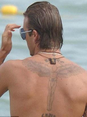 World famous celebrities this david beckham tattoo meaning for David beckham back tattoo
