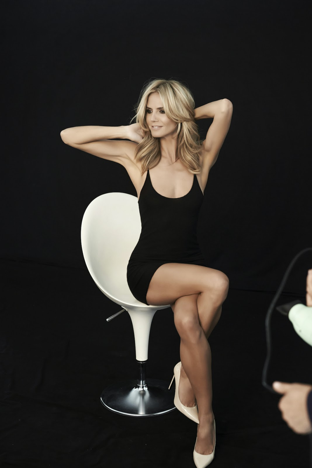 Heidi Klum shows off enviable body for the Sharper Campaign Holiday 2014