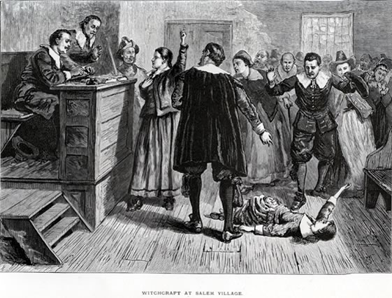 "A generalized courtroom scene showing an ""afflicted"" girl fallen on the floor in front of the judges bench. An accused woman stands in front of the judges holding her right hand over her heart and gesturing upwards, as if in the act of declaring her innocence before God."