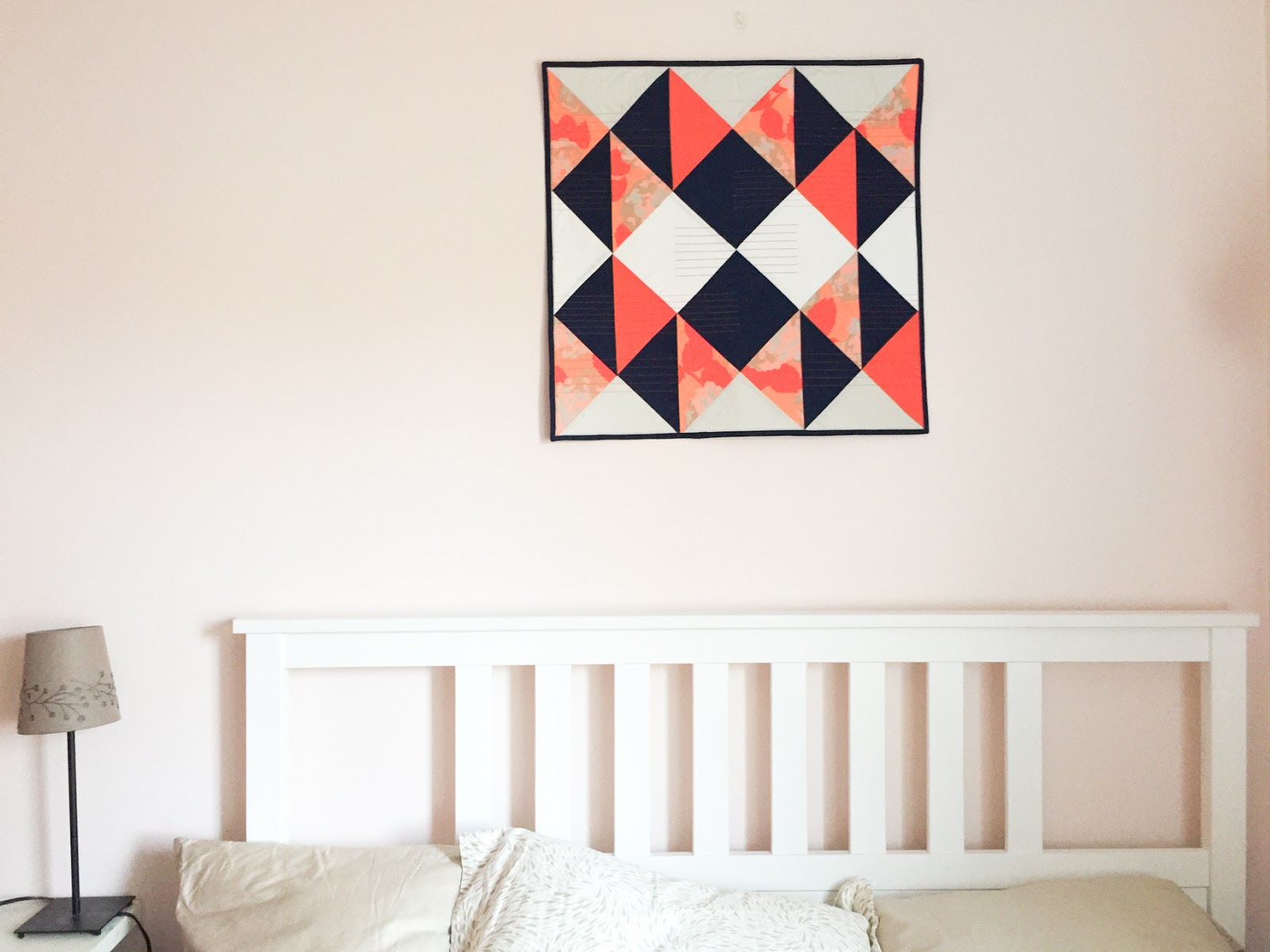 Modern Buckwheat coral and navy wall quilt living in its Boston home   by Lovely and Enough