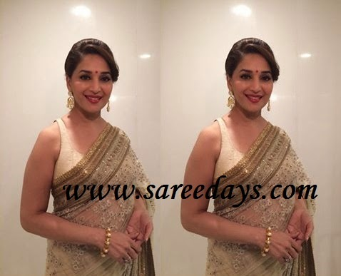 Latest saree designs madhuri dixit in beige designer work saree checkout madhuri dixit in beige designer work saree with embroidery and work border and paired with matching sleeveless blouse altavistaventures Images