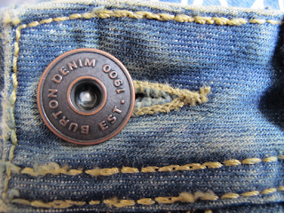 A button on denim jeans