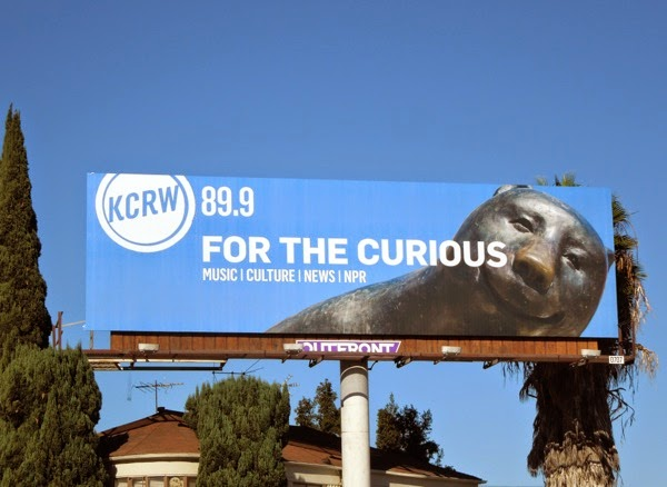 KCRW radio For the curious bear sculpture billboard