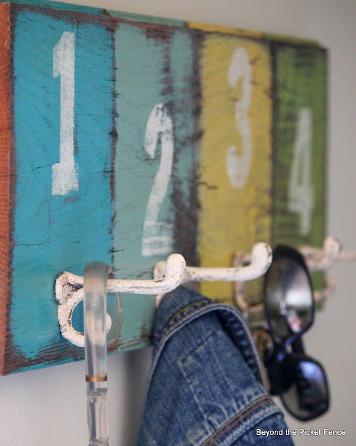 colorful paint, barn wood, coat hook, organization, http://bec4-beyondthepicketfence.blogspot.com/2013/08/off-hook.html