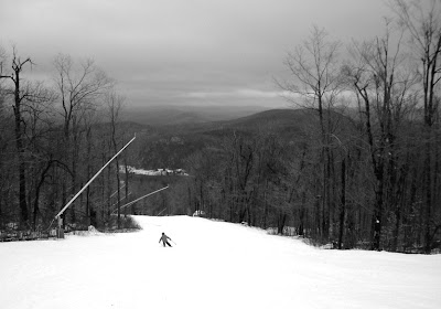 Daniel skiing the Sleighride trail at Gore on a black-and-white day.  The Saratoga Skier and Hiker, first-hand accounts of adventures in the Adirondacks and beyond, and Gore Mountain ski blog.