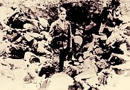 Ustasha guard posing amid a pile of bodies