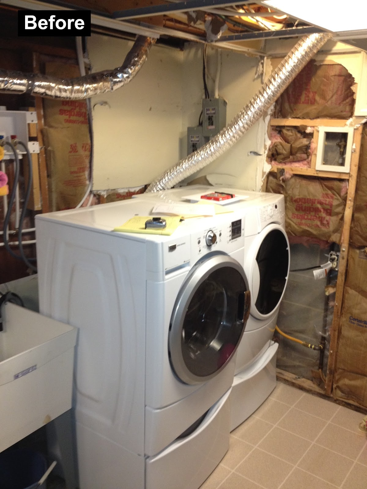 before picture of a laundry space in unfinished section of