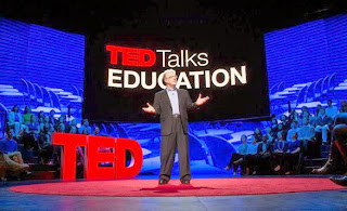 Sir Ken Robinson on stage speaking at the TED conference