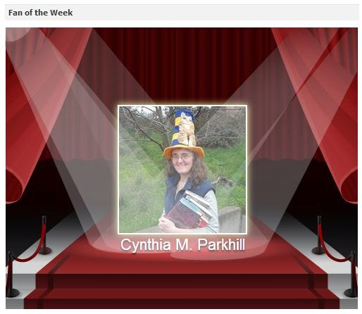 Screen capture: Jackson County Library Services' Fan of the Week on Facebook. My Facebook avatar is displayed on a red carpet with double spotlights shining down from left and right diagonals.