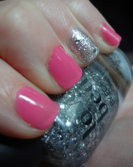 pink nail polish with ring finger silver glitter accent nail
