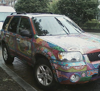 view of front of car showing paisley-type bright colored designs all over car